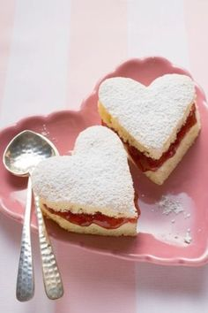 Precious tea sandwiches, filled with jam and dusted with powdered sugar.