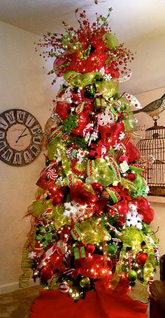 Love this tree. I decorate my tree similar but I put a Santa Hat on top with the pic decor arount it. Got my snata hat at Craker Barrel--has a long, long tail so it hangs well on the tree.
