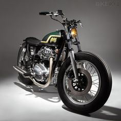 Yamaha XS650 swingarm custom with small green tank , low profile seat and firestones by Mark Huang