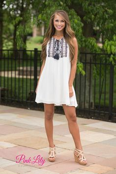 From beach vacations to cookouts, Little White Dresses are a summer essential! Our newest one offers an extra pop of print to really make this standout dress shine! It features black, red, and navy geometric patterns on the bodice; the pattern also continues onto the back panel.