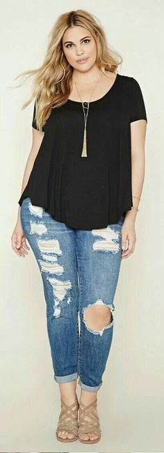 Cute comfy torn jeans and basic black cap sleeve top. Boho tassel necklace