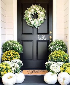 On the lookout for some easy fall porch ideas? Of course you are, because now is the time of year when porch decor comes into its own. Sure you might add few spring flowers at Easter, and hang a wreath at Christmas, but fall is when you can really go to town. Fall Home Decor, Autumn Home, Holiday Decor, Fall Door, Modern Farmhouse Decor, Farmhouse Front, Farmhouse Chic, Front Door Decor, Front Door Paint Colors