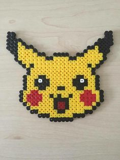 Nerdy pixel bead art made with love by fellow geeks! Bring this sweet and smiling Pikachu into your home and onto your refrigerator! Pikachu magnet