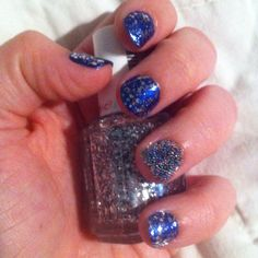 "OPI ""Blue Me Away"" with Essie ""Set In Stones"" over it and OPI Black Onyx on ring finger with clear microbeads on top!"