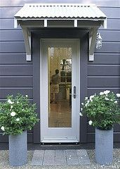 for laundry entry & also like this colour scheme for home- dark charcoal and white could we have a little eave like this?