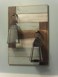 My so-called artwork is a bunch of scrap 1x4's glued together, randomly painted with the same colors used in the bathroom and funky candle lanterns attached to it.