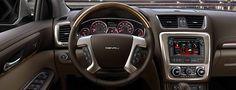 The 2016 GMC Acadia Denali mid-size luxury SUV with standard mahogany wood grain trimmed steering wheel
