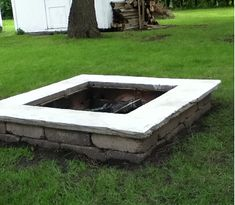 DIY backyard firepit. Retaining wall block, paver glue, concrete mix, scrap wood, shovel & a level is all you need.