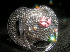 Rhinestoned Bow Pacifier Blinky. $35.00, via Etsy. I could totally make this