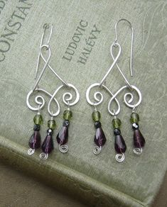Dangling purples and greens... Swinging Spirals and Beads Chandelier by nicholasandfelice on Etsy, $28.00