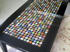 Bottle cap table.  Made using the Windfarm method.  Filled caps with hot glue.  Several coats of resin. Beer bottle caps.
