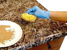 How to paint laminate kitchen counter tops. Want to remodel your kitchen, but can't afford natural stone counter tops? just paint your original laminate counters for the expensive look!
