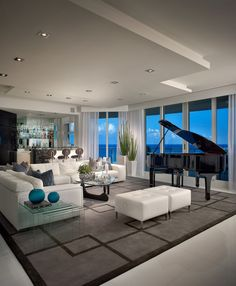Elegant sitting room in white + gray and black.  Excellent.
