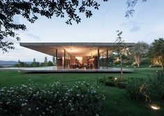 Concrete Home Invites the Outdoors In Through Its Floor to Ceiling Glass Windows (16 pictures)