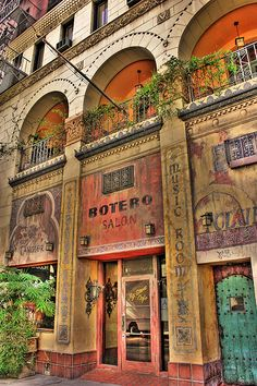 Cafe - Los Angeles - California. Like how the artistic building frames the windows, doors.