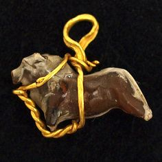 A Rare Middle Assyrian Gold and Agate Bull Pendant (1600 BC - 900 BC)