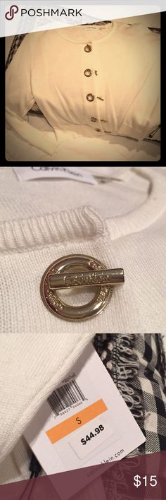⚡️BOGO⚡️Calvin Klein cropped sweater cardigan NWT ivory colored cropped cardigan with toggle buttons and ribbon lining behind grommets and toggles. There is a small stain at the bottom of the left sleeve and a slight pull of thread which can probably be pulled through. Calvin Klein Sweaters Cardigans
