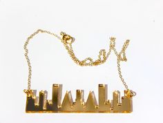 Gold Skyline Necklace Gold Mirrored Acrylic On 14K Gold Filled Trace Chain By TaraMacJewellery on Etsy  https://www.etsy.com/shop/TaraMacJewellery  #acrylicjewellery #etsy #jewellery #giftideas #lasercut #perspexjewellery #lasercutnecklace #geometric #geometricjewellery #skyline #urbanskyline #london #newyork #acrylic
