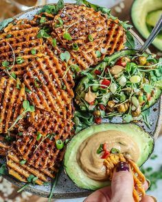 Celebrating FRYday with some SALT and VINEGAR waffled sweet potato fries and a spicy tahini-almond-sriracha dip…and a chickpea salad stuffed avocado 🥑 I bought a waffle fry maker and it was the best $20...