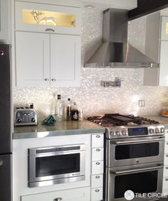 Amazing mother of pearl tile backsplash.  The sheen is gorgeous.   Available at www.tilecircle.com