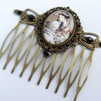 This romantic hair comb is genuine highlights. It consists of bronze metal and is staffed with  setting with handmade glass Cabochon. The hair comb is also decorated with black high quality rhinestones.  The hair comb measures 5,5 L x 6,5 W cm.
