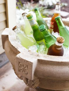 Keep Drinks Cold-Keep Drinks Cold  A plastic-lined urn is on chill duty: Line this porch staple with a garbage bag, fill with ice, and tuck in an array of sodas and drinks for a grab-as-you-like atmosphere