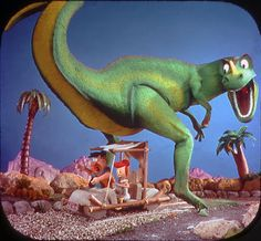 View-Master image of Fred and Wilma | Tags: Hanna-Barbera, The Flintstones, car, driving, dinosaur