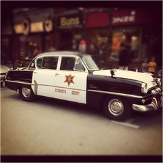 Nice photo of an old police car.