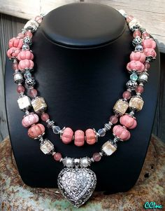 heart pendant and pink beads, what could make this necklace any better?!