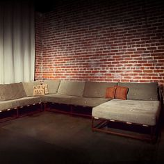 I want a living room this big, this couch and the exposed brick wall. Please and thank you.