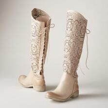 A pretty skirt or dress will set off the distinctive contours of these laser-cut, lace-up leather boots.