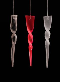 Plexiglass twirl hangers on Behance