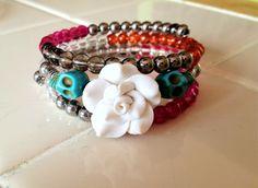 Memory wire skull and flower bracelet!! $20.00, via Etsy.