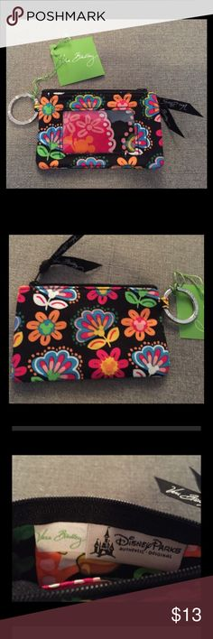 Vera Bradley Disney Midnight Mickey Zip ID Case Brand New With Tags never used Disney Midnight Mickey Zip ID Case.  Disney Park exclusive. Multiple available, photos are representative of the item, same fabric exact positioning of pattern may differ slightly. From a pet-free / smoke-free  home.  Thanks for looking! Vera Bradley Bags Wallets