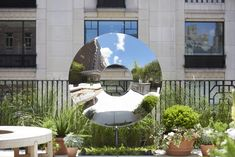 A mirrored metal sculpture brings dynamic energy to the space.