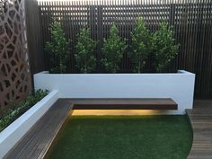 Modern Courtyard with Floating Bench Seat. Lump Sculpture Screen