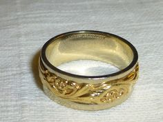 Vintage 14k Gold Unisex Ring White and Yellow Art Carved Band Size 9.5 Mens Womans Ring by GoodysFromThePast on Etsy https://www.etsy.com/listing/224450125/vintage-14k-gold-unisex-ring-white-and