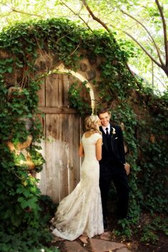 bride and groom photo idea Salt Lake Temple LDS wedding at Tuscany Italian Restaurant featured on Ever-Ours  http://ever-ours.com/real-wedding-a-sweet-lds-wedding-at-salt-lake-city