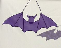Purple stained glass bat. Halloween window decoration. Item is 9 inches by 4 inches and comes with hanging chain. Custom color requests please contact seller. I will make this in any color you like at time of purchase. If no color is specified it will be purple as shown in the picture.