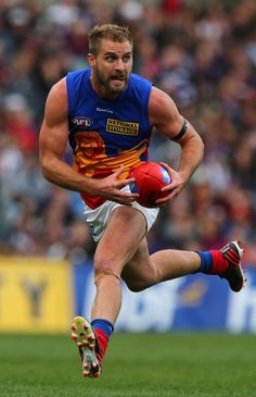 Joel Patfull of the Lions gathers the ball during the round 12 AFL match between the Fremantle Dockers and the Brisbane Lions at Patersons Stadium on June 15, 2013 in Perth, Australia.