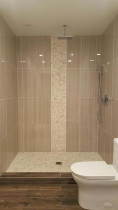 Large sliced white pebble tile luxury shower