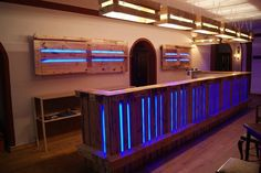 In this interesting idea of the wine bar you will view the amazing use of the wood pallet material that is covering the whole front side of the table. This wood pallet is even accompanying at the side portions of the shelves that is hanging with wall.