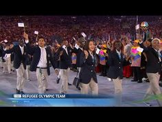 Team Refugees Gets Standing Ovation At Olympics Opening Ceremony
