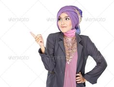 young moslem woman pointing - Stock Photo - Images