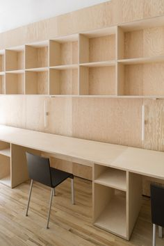 Plywood design office; looks nice and simple; notice the .03 chairs by Maarten Van Severen.