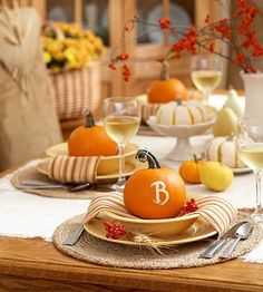 a monogrammed pumpkin at each place setting~ love this Thanksgiving tablescape