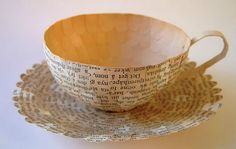 paper cups made from old book pages ! Love this artist's work...click thru to the website. Amazing!