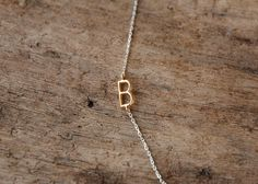 initial necklace sideways delicate gold by sticksandstonesny