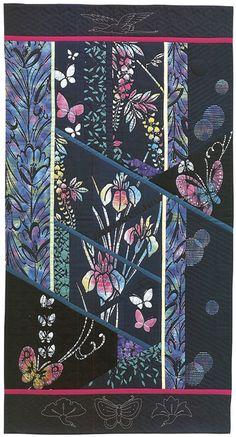 Batik Garden by Kitty Pippen ...interesting asymmetrical blocks and binding-look sashing.