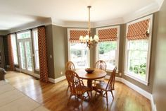 This shows how you can use the same fabric with for different treatments to tie large open areas together.  -Three flat roman shades in breakfast room and two double width panels to frame the door and square off the room.  With functional treatments as these, you can have complete privacy whenever you want.